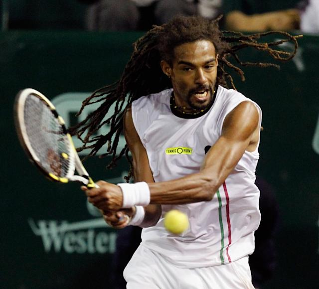 Dustin Brown hits a return against John Isner at the U.S. Men's Clay Court Championship tennis tournament on Wednesday, April 9, 2014, in Houston. (AP Photo/Houston Chronicle, Bob Levey)