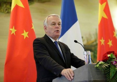 French Foreign Minister Jean-Marc Ayrault attends a joint news conference in Beijing