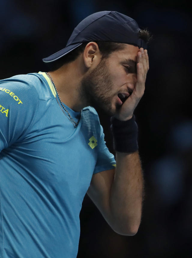 Italy's Matteo Berrettini reacts after missing a shot as he plays against Serbia's Novak Djokovic during their ATP World Tour Finals singles tennis match at the O2 Arena in London, Sunday, Nov. 10, 2019. (AP Photo/Alastair Grant)