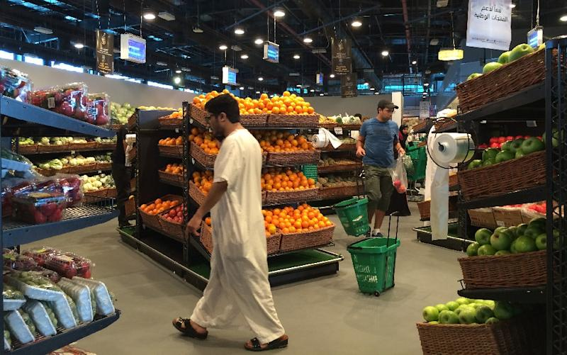 Customers are seen shopping at the al-Meera market in the Qatari capital Doha, on June 10, 2017. Saudi Arabia, Egypt, the UAE and Bahrain announced on June 5 they were cutting diplomatic ties and closing air, sea and land links with Qatar