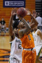 Oklahoma State guard Avery Anderson III (0) shoots in front of Baylor guard Jared Butler (12) in the second half of an NCAA college basketball game Saturday, Jan. 23, 2021, in Stillwater, Okla. (AP Photo/Sue Ogrocki)