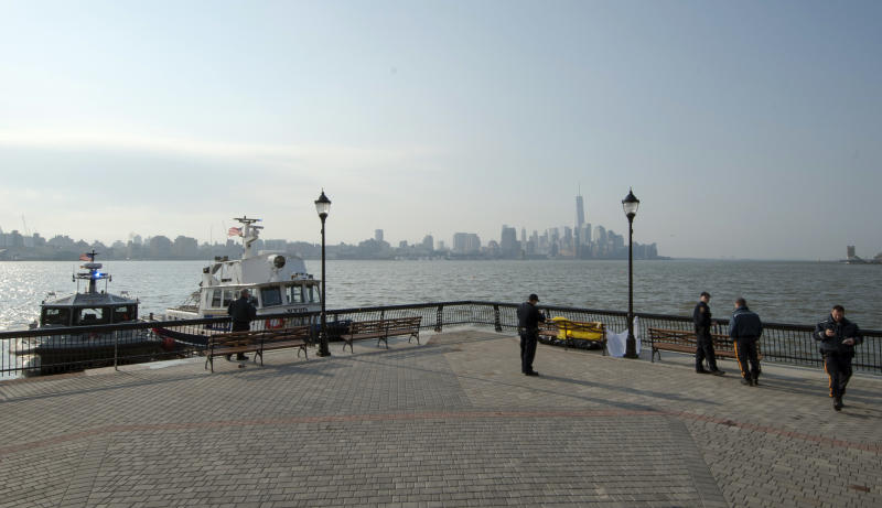 Police investigate the scene after divers found the bodies of two people in the Hudson River near Sinatra Park, Sunday, April 13, 2014 in Hoboken, N.J. Police have not identified the victims. (AP Photo/Joe Epstein)