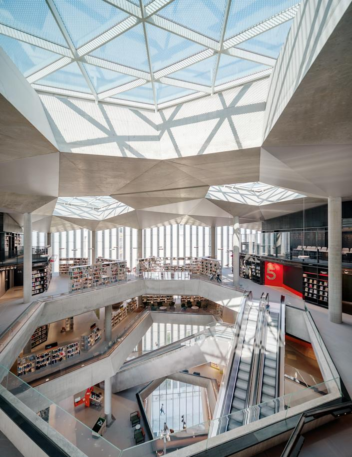 The interiors are light-filled due to the abundant windows, open spaces throughout, and a central skylight.