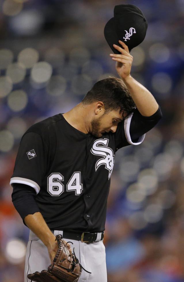 Chicago White Sox starting pitcher Andre Rienzo wipes off his forehead during the sixth inning of a baseball game against the Kansas City Royals at Kauffman Stadium in Kansas City, Mo., Tuesday, May 20, 2014. (AP Photo/Orlin Wagner)