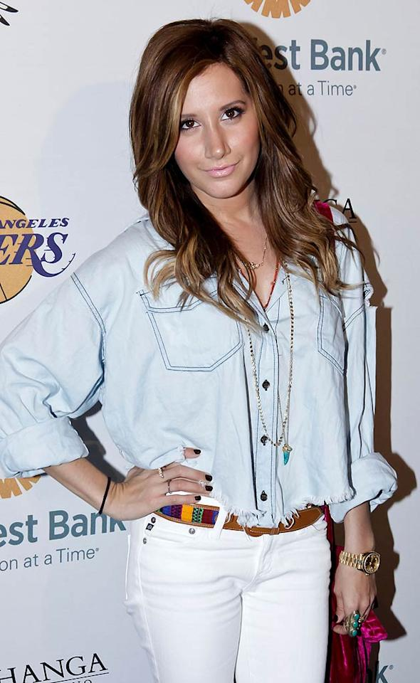 "Ashley Tisdale sported white jeans and a pale blue denim top at the charity bash, which was held after the Lakers' game against the Denver Nuggets on Sunday. ""Had so much fun at the lakers game! Really nice seeing @KhloeKardashian. She is so nice!"" tweeted the Tis of her night out. After a 14-game winning streak at home, the Lakers lost to the Nuggets 95-90. Tibrina Hobson/<a href=""http://www.wireimage.com"" target=""new"">WireImage.com</a> - April 3, 2011"