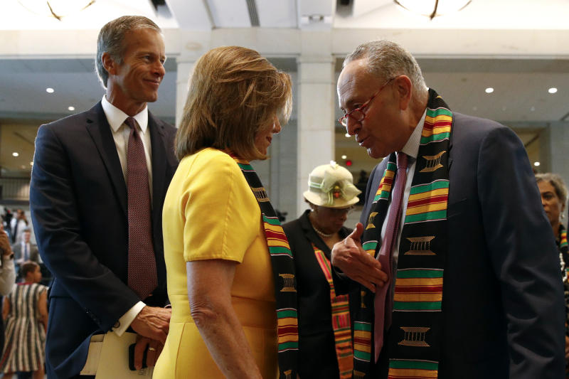 Senate Minority Leader Sen. Chuck Schumer of N.Y., right, speaks with House Speaker Nancy Pelosi of Calif. as Sen. John Thune, R-S.D., left, stands by during a ceremony to commemorate the 400th anniversary of the first recorded arrival of enslaved African people in America, Tuesday, Sept. 10, 2019, on Capitol Hill in Washington. (AP Photo/Patrick Semansky)