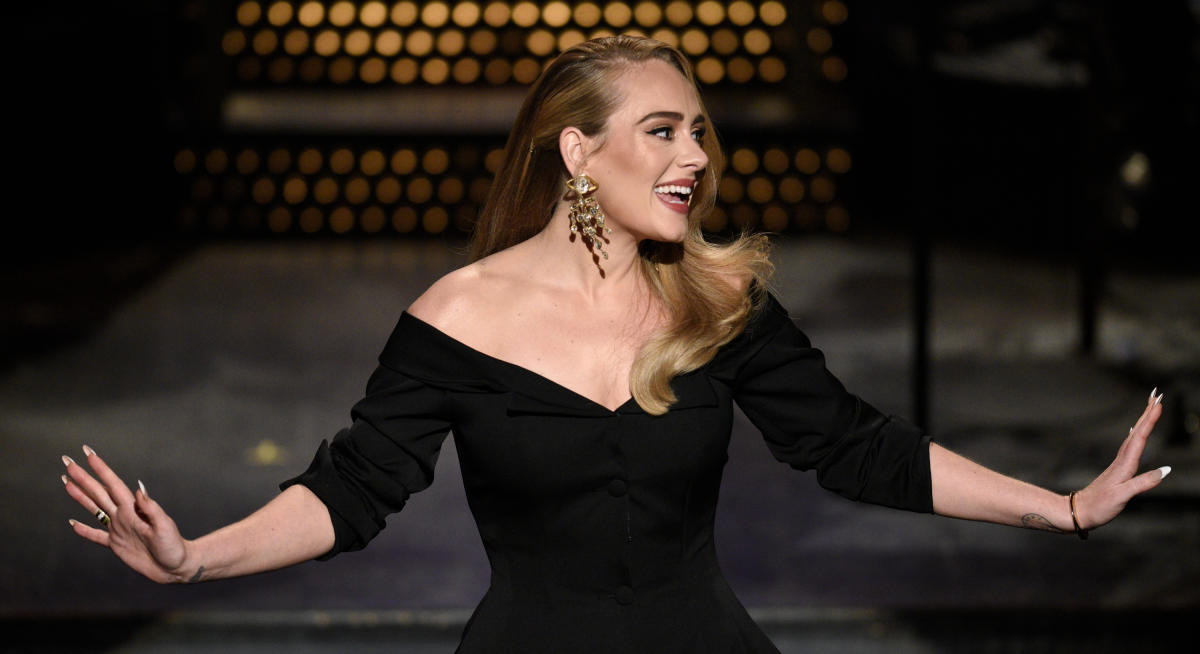 Adele wows in stunning monochrome dress as she attends wedding with boyfriend