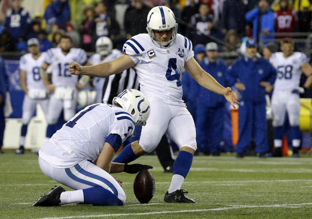 FILE - In this Jan. 11, 2014 file photo,Indianapolis Colts' Adam Vinatieri (4) kicks a field goal as punter Pat McAfee (1) holds the ball during the second half of an AFC divisional NFL playoff football game against the New England Patriots in Foxborough, Mass. The Colts re-signed Vinatieri on Tuesday, March 11, 2014, hours before he was to become an unrestricted free agent. Vinatieri is widely considered the best clutch kicker in league history. (AP Photo/Matt Slocum, File)