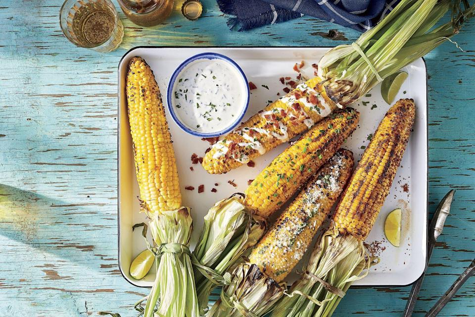 """<p><strong>Recipe:</strong> <a href=""""https://www.southernliving.com/recipes/grilled-corn-on-cob"""" rel=""""nofollow noopener"""" target=""""_blank"""" data-ylk=""""slk:Classic Grilled Corn on the Cob"""" class=""""link rapid-noclick-resp"""">Classic Grilled Corn on the Cob</a></p> <p>Grilled Corn on the Cob was made for days in the sun. Pair this bright veggie with your next hot dog cookout.</p>"""