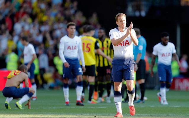 Harry Kane applauds the fans after Spurs saw their unbeaten run ended at Watford - AP
