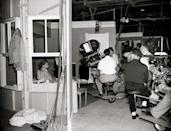 <p>In 1951, Lucille and Desi premiered their hit show <em>I Love Lucy</em>, which featured them as a married couple living in New York City. Here, the actress is seen through the set's window.</p>