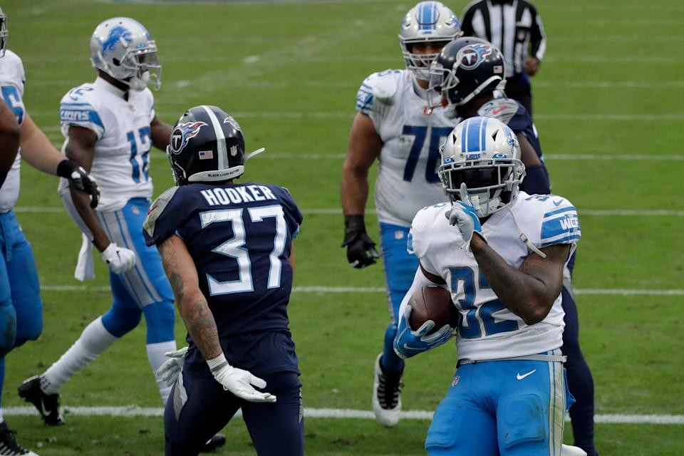 Lions running back D'Andre Swift celebrates after scoring against the Titans during the first half on Sunday, Dec. 20, 2020, in Nashville, Tennessee.