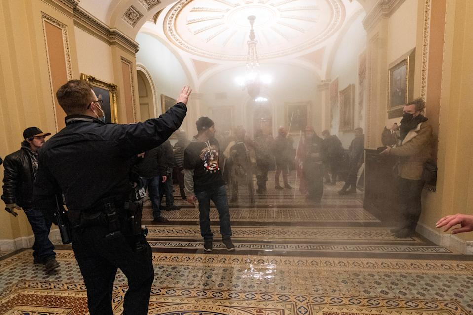 <p>Rioters inside the US Capitol on 6 January. Donald Trump told them: 'We love you, you are very special'</p> (Photo by Alex Wong/Getty Images)