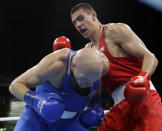 FILE - In this Monday, Aug. 15, 2016, file photo, Russia's Evgeny Tishchenko, right, fights Kazakhstan's Vassiliy Levit during a men's heavyweight 91-kg final boxing match at the 2016 Summer Olympics in Rio de Janeiro, Brazil. After a half-decade of turmoil and drama at the highest levels of Olympic boxing, the sport's trip to Tokyo looks as if it could be fairly smooth. At least as smooth as this notoriously chaotic sport ever gets.(AP Photo/Frank Franklin II, File)