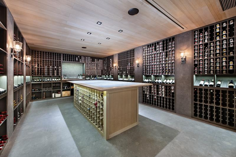 A 5,000-bottle wine cellar and an exotic fish tank add an opulent flair to the property. Photo by: Platinum Luxury Auctions.