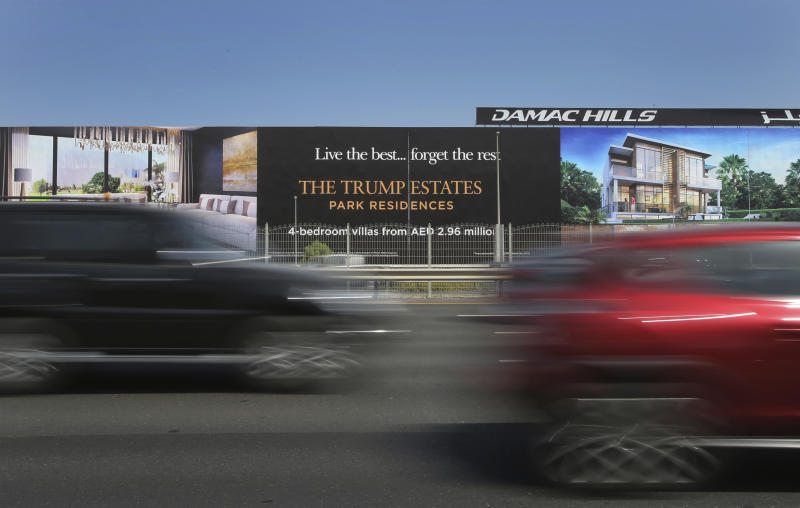 FILE - In this Aug. 9, 2017, file photo, cars pass a giant billboard adverting DAMAC Properties' Trump Estates golf course villas in Dubai, United Arab Emirates. DAMAC Properties, Dubai's largest, fully private real estate developer, on Sunday, March 29, 2020, posted its first yearly loss since becoming a publicly traded company in 2013, a worrying sign for the sheikhdom's already-reeling vital property market now struggling with the new coronavirus pandemic. (AP Photo/Kamran Jebreili, File)