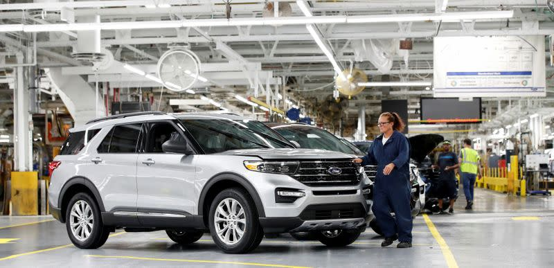 FILE PHOTO: A worker checks a 2020 Ford Explorer car at Ford's Chicago Assembly Plant in Chicago