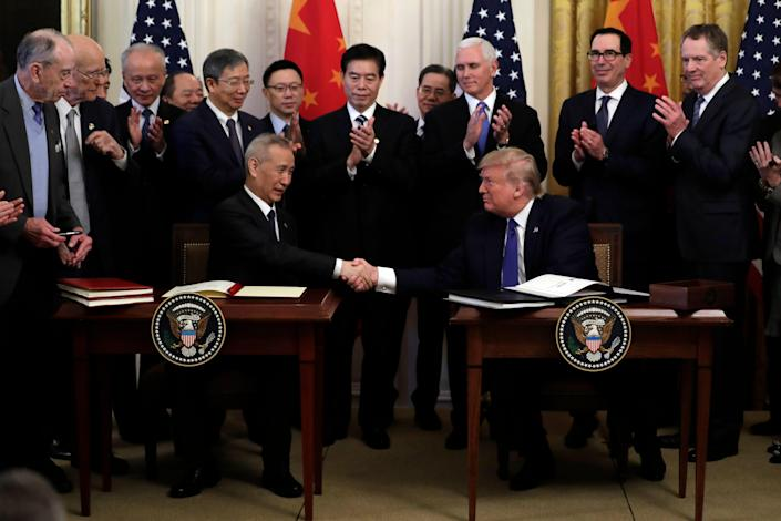 President Donald Trump and Chinese Vice Premier Liu He sign the U.S.-China trade agreement in the East Room of the White House.