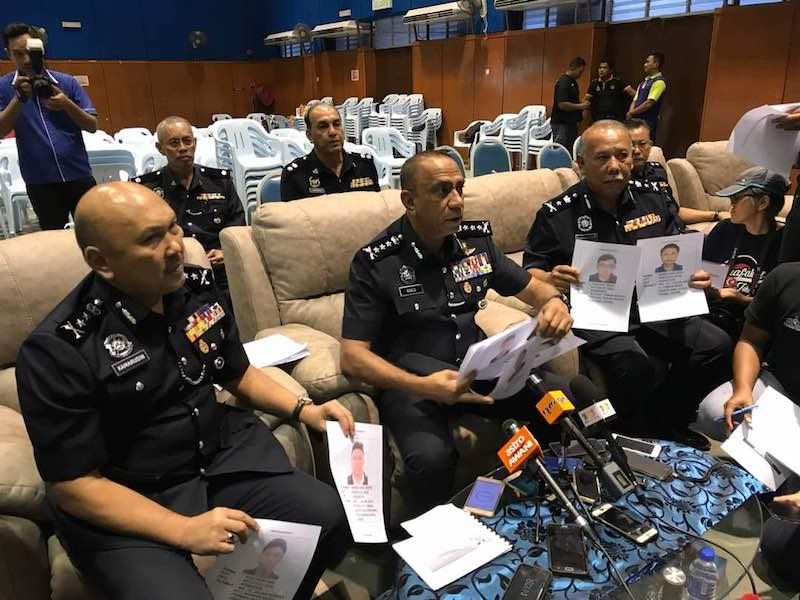 Johor police chief Datuk Mohd Khalil Kader Mohd (centre) flanked by his deputy Datuk Mohd Kamarudin Md Din and Johor criminal investigations department (CID) chief Kamaluddin Kassim. — Picture by Ben Tan
