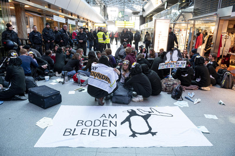 Climate activists block the entrance hall of the Tegel airport in Berlin, Germany, Sunday, Nov. 10, 2019. (Fabian Sommer/dpa via AP)