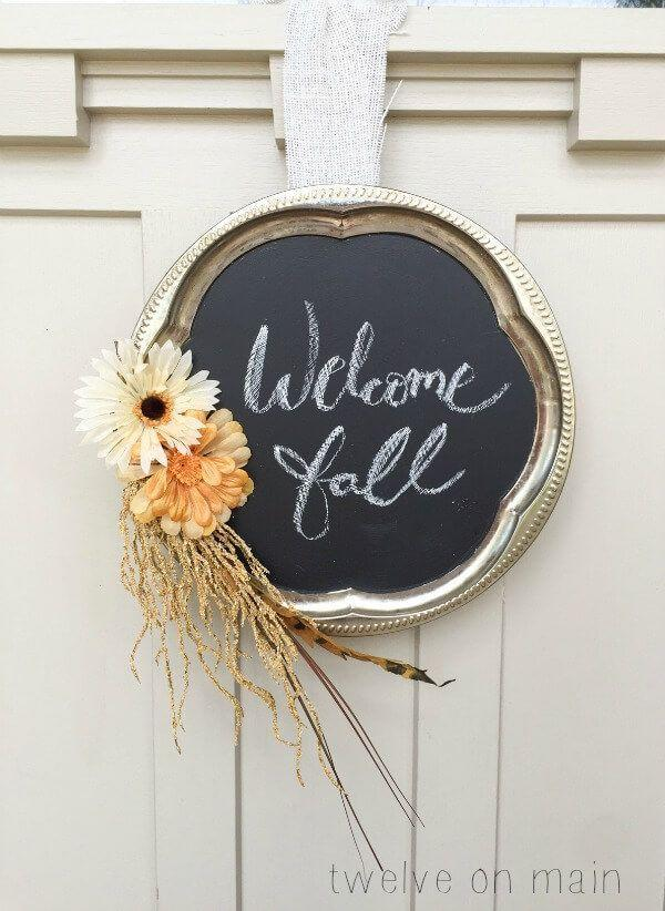 """<p>A chalkboard makes for a sweet touch to your seasonal decor. After you create this charming DIY, ask your kids to help you think of a different phrase for each day of fall.</p><p><strong>Get the tutorial at <a href=""""https://www.twelveonmain.com/chalkboard-style-fall-wreath/"""" rel=""""nofollow noopener"""" target=""""_blank"""" data-ylk=""""slk:Twelve on Main"""" class=""""link rapid-noclick-resp"""">Twelve on Main</a>.</strong> </p>"""