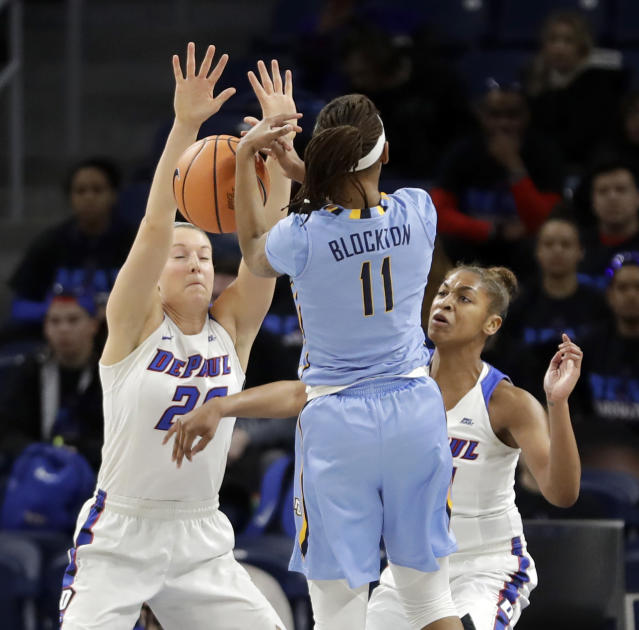 DePaul's Amarah Coleman, right, strips the ball from Marquette's Allazia Blockton (11) as Kelly Campbell watches during the first half of an NCAA college basketball game in the championship of the Big East conference tournament, Tuesday, March 6, 2018, in Chicago. (AP Photo/Charles Rex Arbogast)