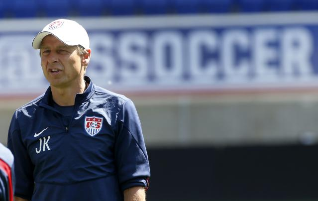 Jurgen Klinsmann, head coach of the U.S. men's national soccer team, talks with his team during a team training session in Harrison