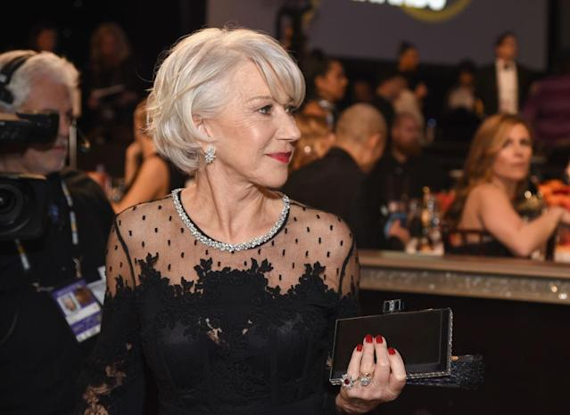 <p>Mirren sported a classy scarlet red mani that stood out against her elegant black dress. (Photo: Getty Images) </p>