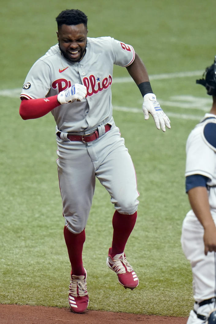 Philadelphia Phillies' Roman Quinn (24) screams in pain after he was injured scoring on a two-run double by Ronald Torreyes during the fifth inning of a baseball game against the Tampa Bay Rays Saturday, May 29, 2021, in St. Petersburg, Fla. (AP Photo/Chris O'Meara)