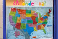 """A map of the United States is hung on a window with a sign reading, """"Where are you going?"""" at Casa Alitas, a Catholic-run shelter for migrant families who have left their home countries to escape violence and poverty in Tucson, Ariz., Friday, Feb. 21, 2020. In numerous cities along the border with Mexico, Catholic-run agencies are outspoken advocates for migrants and asylum seekers hoping to reach the U.S. (AP Photo/Dario Lopez-MIlls)"""