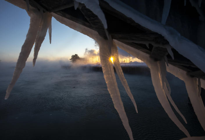 The sun rises behind icicles formed on the harbor in Port Washington, Wis., on Jan. 30, 2019. A deadly arctic deep freeze enveloped the Midwest with record-breaking temperatures. (Photo: Jeffrey Phelps/AP)
