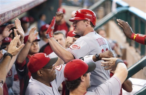 Cincinnati Reds' Jay Bruce, center, is congratulated by teammates after hitting a three-run home run during the eighth inning of a baseball game against the Houston Astros, Sunday, Sept. 2, 2012, in Houston. (AP Photo/Dave Einsel)