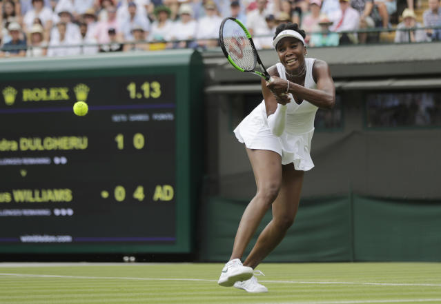 Venus Williams of the US returns the ball to Alexandra Dulgheru of Romania during their women's singles match on the third day at the Wimbledon Tennis Championships in London, Wednesday July 4, 2018. (AP Photo/Ben Curtis)