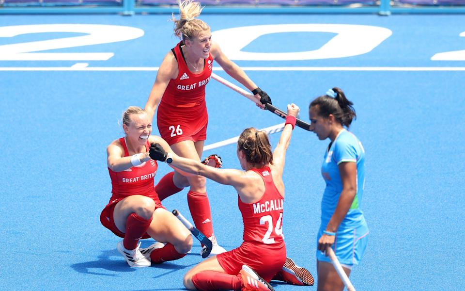 Hannah Martin, Shona McCallin and Lily Owsley of Team Great Britain celebrate after winning the Women's Bronze medal match between Great Britain and India on day fourteen of the Tokyo 2020 Olympic Games at Oi Hockey Stadium on August 06, 2021 in Tokyo, Japan
