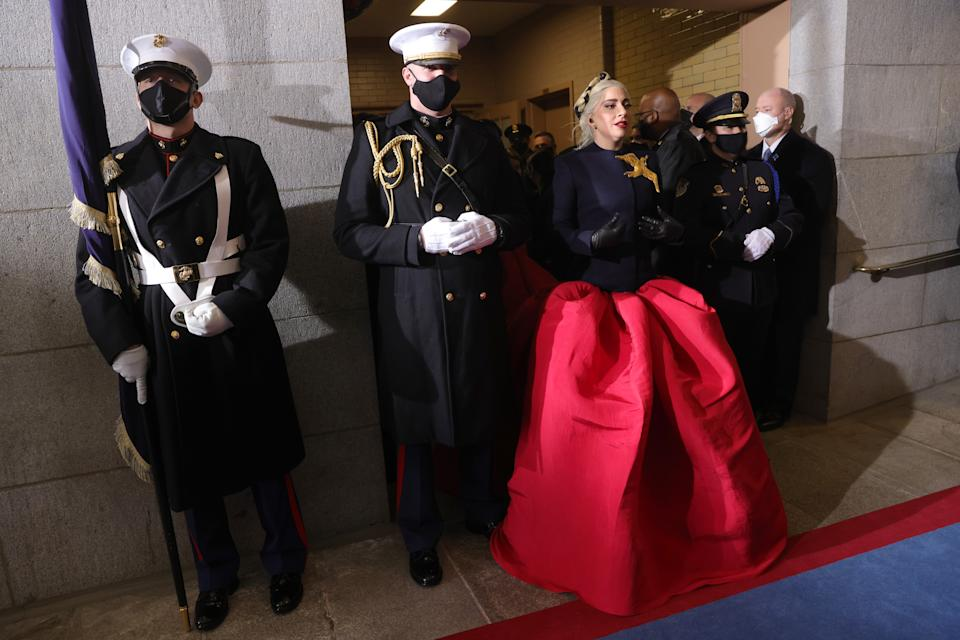 WASHINGTON, DC - JANUARY 20: Lady Gaga with Marine escort Capt. Evan Campbell to sing the National Anthem at the inauguration of U.S. President-elect Joe Biden on the West Front of the U.S. Capitol on January 20, 2021 in Washington, DC. During today's inauguration ceremony Joe Biden becomes the 46th president of the United States. (Photo by Win McNamee/Getty Images)