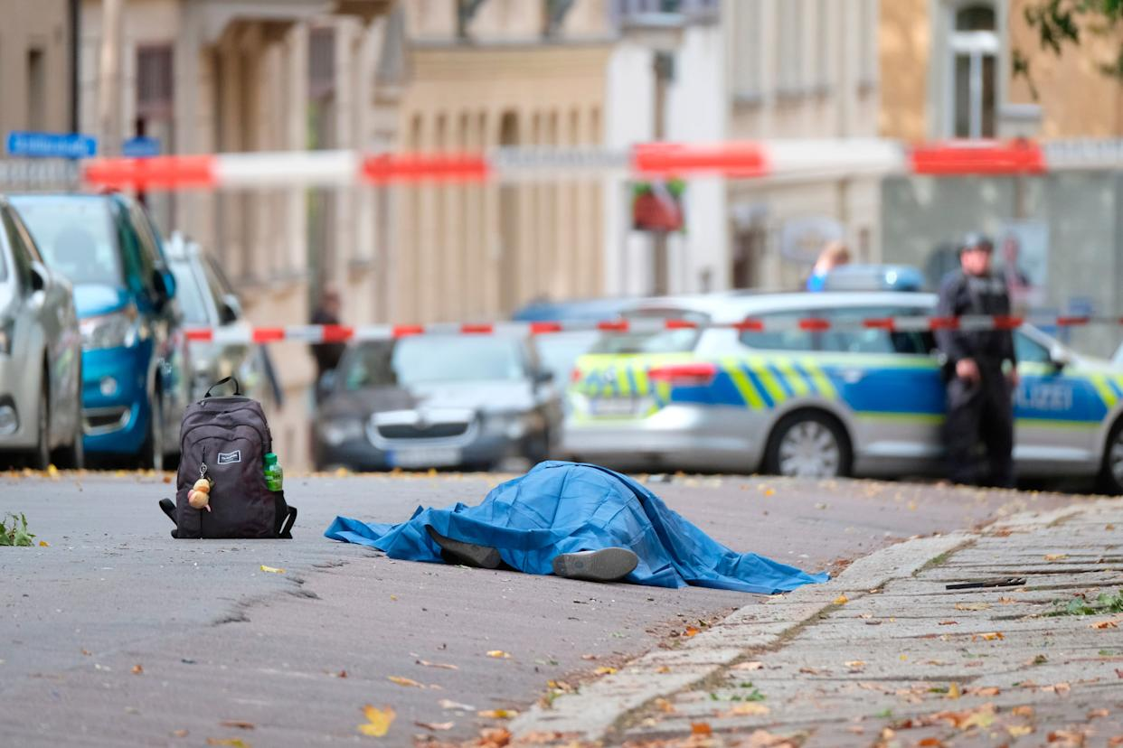 A person lies on a road in Halle, Germany, Wednesday, Oct. 9, 2019. A gunman fired several shots and at least two people were killed, according to local media. (Photo: ASSOCIATED PRESS)