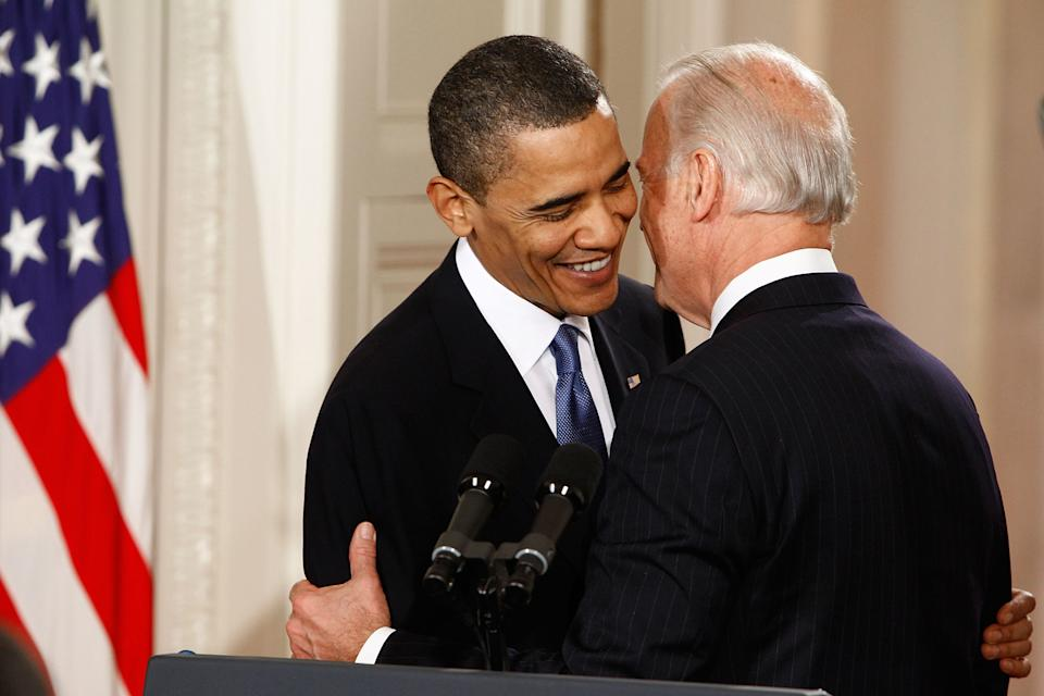 WASHINGTON - MARCH 23:  U.S. President Barack Obama (L) is embraced by Vice President Joe Biden before signing the Affordable Health Care for America Act during a ceremony in the East Room of the White House March 23, 2010 in Washington, DC. Biden was heard on an open microphone during this exchange telling the president,