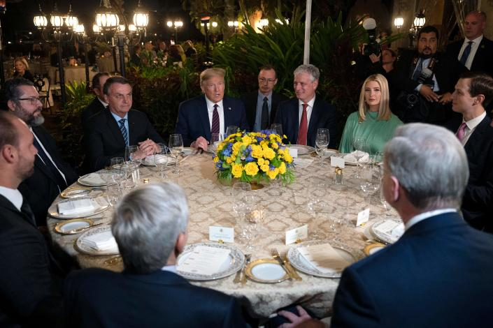 President Trump sits with Brazilian President Jair Bolsonaro, left, national security adviser Robert O'Brien, Ivanka Trump and Jared Kushner during a diner at Mar-a-Lago in Palm Beach, Fla. (Jim Watson/AFP via Getty Images)