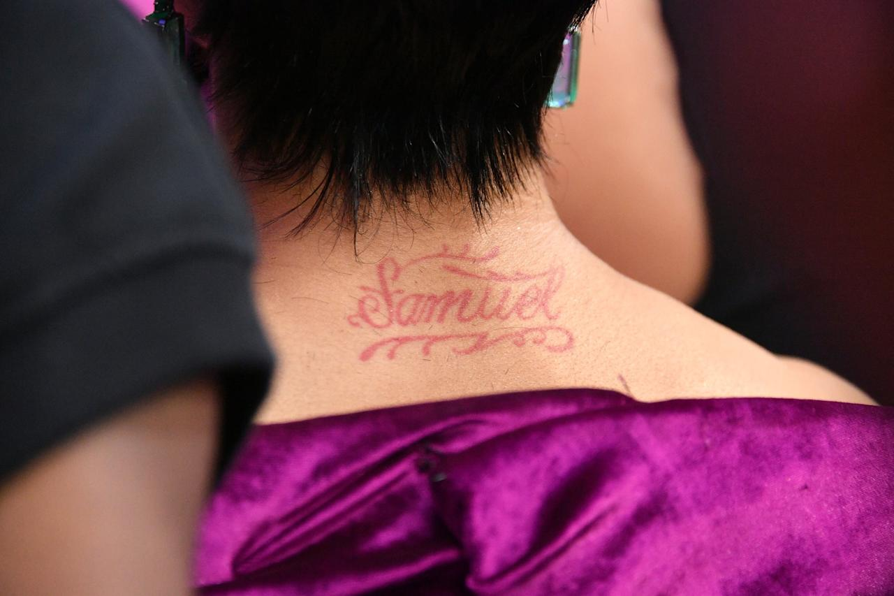 "<p>Cardi B previously had the name ""Samuel"" tattooed on the back of her neck in red ink, though she's never revealed the meaning. Fans speculate Samuel may be the name of an ex, as the rapper told <a class=""sugar-inline-link ga-track"" title=""Latest photos and news for Ellen DeGeneres"" href=""https://www.popsugar.com/Ellen-DeGeneres"" target=""_blank"" data-ga-category=""Related"" data-ga-label=""https://www.popsugar.com/Ellen-DeGeneres"" data-ga-action=""&lt;-related-&gt; Links"">Ellen DeGeneres</a> during an appearance on her show in October 2019 that <a href=""http://www.youtube.com/watch?v=Vl3neL2_OLE"" target=""_blank"" class=""ga-track"" data-ga-category=""Related"" data-ga-label=""http://www.youtube.com/watch?v=Vl3neL2_OLE"" data-ga-action=""In-Line Links"">she had more than one ex's name tattooed</a> on her body. ""I have like three different men tatted on me, you know what I'm saying? They gotta go!"" she said. Later, in June 2020, Cardi B tweeted a <a href=""http://twitter.com/iamcardib/status/1277811516620881920"" target=""_blank"" class=""ga-track"" data-ga-category=""Related"" data-ga-label=""http://twitter.com/iamcardib/status/1277811516620881920"" data-ga-action=""In-Line Links"">picture of her new butterfly tattoo cover up</a>, writing, ""I never showed ya my cover tatt. What ya think?"" </p>"