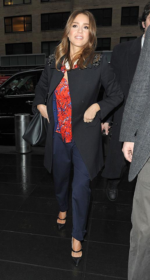 Next, the 30-year-old actress arrived to tape an interview with CNN's Piers Morgan in another colorful outfit made up of a red printed top and blue pants under a black coat. While Jessica changed her clothes several times during the day, the hot mama left her wavy locks alone. We're sure Piers didn't mind! (01/17/2012)