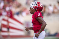 Indiana quarterback Michael Penix Jr. (9) leaves the field after warming up before an NCAA college football game against Idaho, Saturday, Sept. 11, 2021, in Bloomington, Ind. (AP Photo/Doug McSchooler)