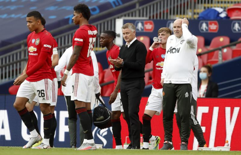 Manchester United's manager Ole Gunnar Solskjaer stands on the touchline during the English FA Cup semifinal soccer match between Chelsea and Manchester United at Wembley Stadium in London, England, Sunday, July 19, 2020. (Andy Rain, Pool via AP)