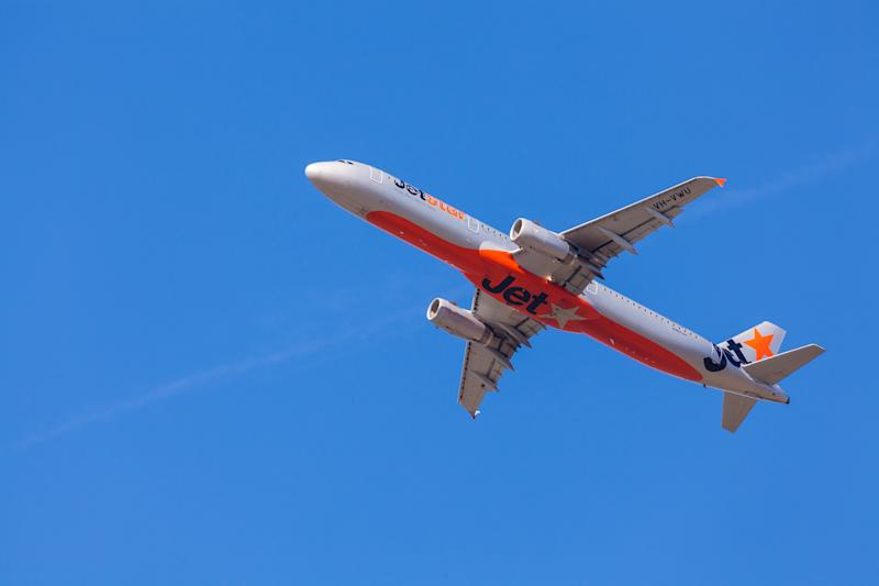 Jetstar cuts domestic and New Zealand flights by more than half for a sale this week in Australia. Photo: Getty Images