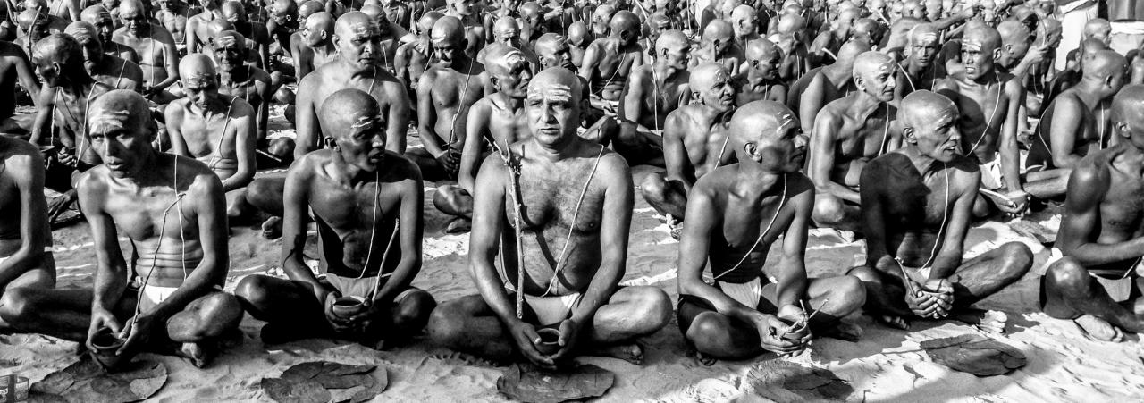 ALLAHABAD, INDIA - FEBRUARY 08: (EDITORS NOTE: Image was created using the iPhone panoramic application) Naga sadhus, naked Hindu holy men, participate in an initiation ceremony on the banks of the Ganges river during the Maha Kumbh Mela on February 8, 2013 in Allahabad, India. The Maha Kumbh Mela, believed to be the largest religious gathering on earth is held every 12 years on the banks of Sangam, the confluence of the holy rivers Ganga, Yamuna and the mythical Saraswati. The Kumbh Mela alternates between the cities of Nasik, Allahabad, Ujjain and Haridwar every three years. The Maha Kumbh Mela celebrated at Sangam, is the largest and holiest, celebrated over 55 days, it is expected to attract over 100 million pilgrims who will bathe in holy waters to wash away their sins. (Photo by Daniel Berehulak/Getty Images)