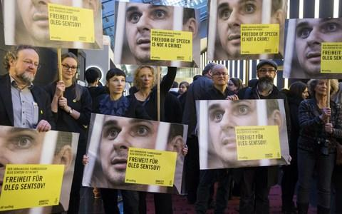 Well-known actresses and others call for Oleg Sentsov's freedom at a rally during the Berlin film festival in February. He has since begun a hunger strike - Credit: Mehmet Kaman/Anadolu/Getty Images