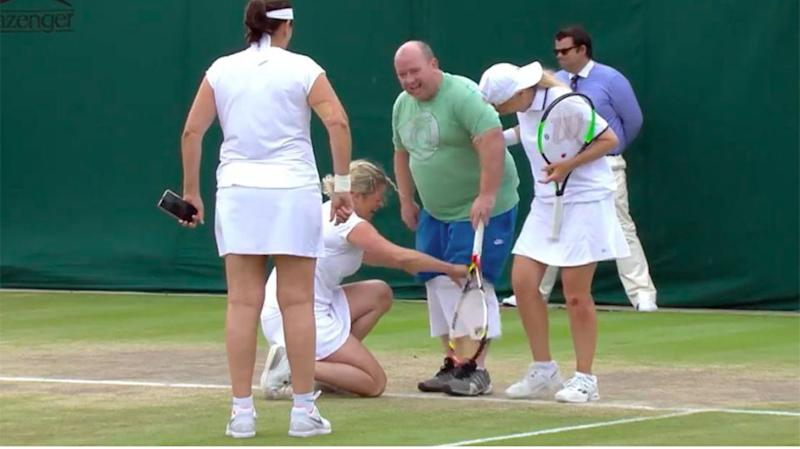 Clijsters lends the man a skirt. Pic: Youtube/Wimbledon