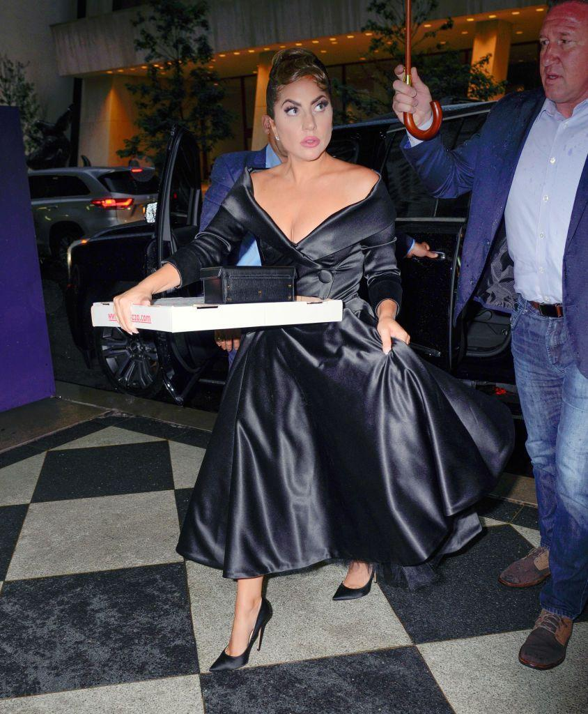 <p>The American-Italian star made sure to grab a pizza before heading back to her hotel in a custom-made silk dress by Dallas Coulter.</p>
