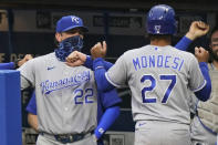 Kansas City Royals' Adalberto Mondesi (27) is congratulated by manager Mike Matheny (22) after scoring during the third inning of the team's baseball game against the Cleveland Indians, Thursday, Sept. 10, 2020, in Cleveland. (AP Photo/Tony Dejak)