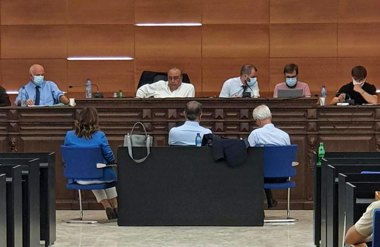 French judicial investigators hear fugitive ex-auto tycoon Carlos Ghosn (front row-C) as a witness, at a courtroom in the Lebanese capital Beirut, on May 26, 2021, ahead of further questioning