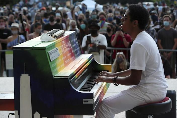 "Jon Batiste performs at Brooklyn's Central Library on June 19 in a special event to celebrate Juneteenth and encourage voter participation and registration. <span class=""copyright"">(mpi43/MediaPunch/IPx)</span>"